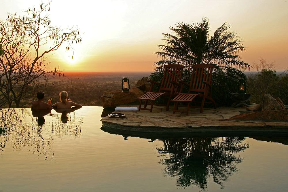 Looking out over Meru National Park from the main pool - Elsa's Kopje. Copyright Cheli & Peacock.